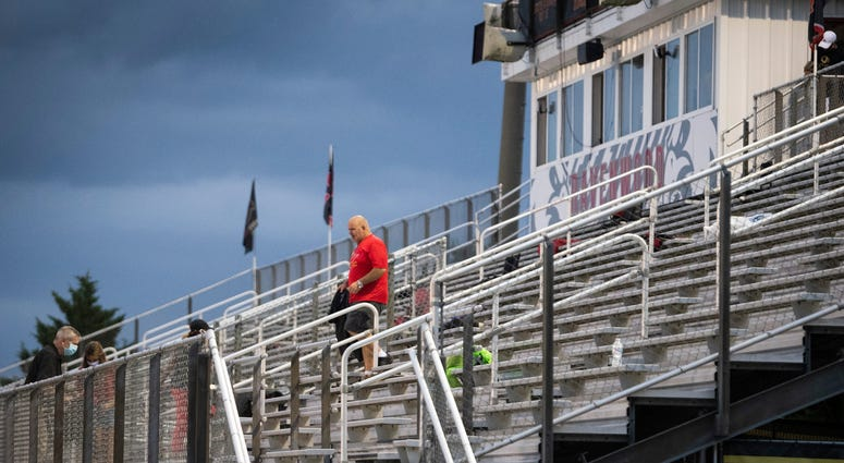 A Ravenwood fan leaves the stadium before their game against Blackman during a weather delay at Ravenwood High School Thursday, Aug. 27, 2020 Nashville, Tenn.
