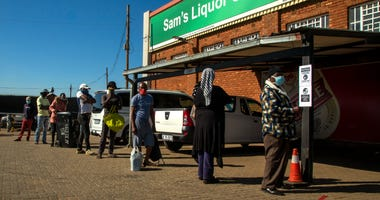South Africa eases; liquor is sold, school openings delayed