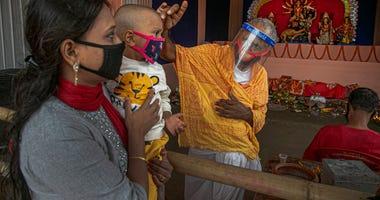 India's festive season spawns fears of renewed virus surge