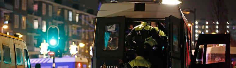 Belgium fears spread of Dutch riots over virus restrictions