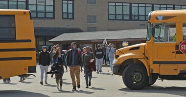 Mar 13, 2020; Millcreek, PA, USA; McDowell High School students leave school on an early dismissal,