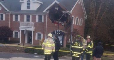 Porsche crashes into NJ office building