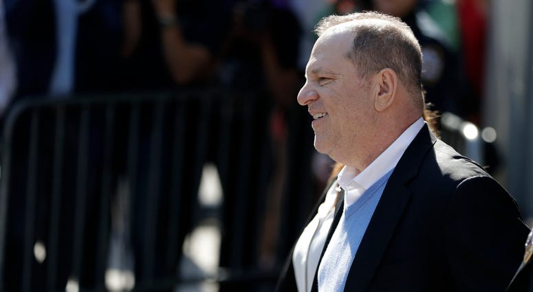Harvey Weinstein leaves the first precinct of the New York City Police Department after turning himself to authorities following allegations of sexual misconduct, Friday, May 25, 2018