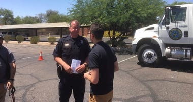 Scottsdale Police Sgt. Ben Hoster speaks to a member of the news media at the scene of a fatal shooting in Scottsdale, Ariz., on Saturday, June 2, 2018.