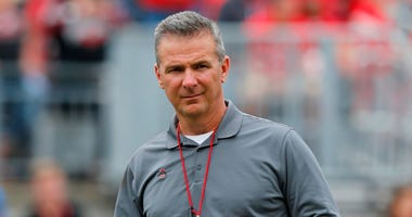 FILE - In this April 14, 2018, file photo, Ohio Setate coach Urban Meyer watches the NCAA college football team's spring game in Columbus, Ohio.
