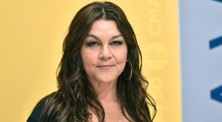 FILE - In this Nov. 2, 2016, file photo, Gretchen Wilson arrives at the 50th annual CMA Awards