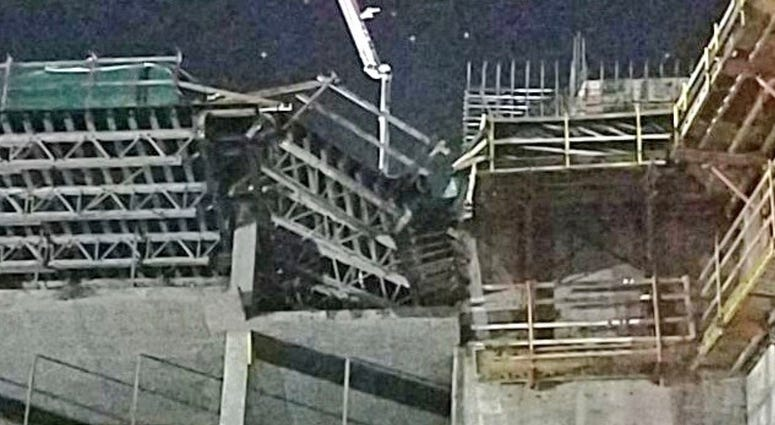 This shows the collapsed scaffolding, top center, at a hotel under construction after two workers fell to their deaths early Wednesday, Aug. 29, 2018, near Orlando, Fla.