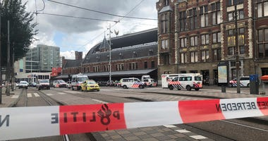 Dutch police officers near the scene of a stabbing attack near the central daily station in Amsterdam, the Netherlands, Friday Aug. 31, 2018.