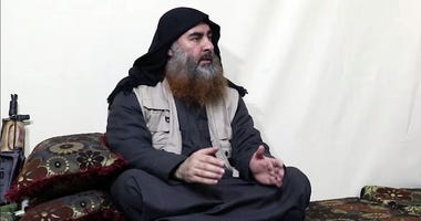 This image made from video posted on a militant website on Monday, April 29, 2019, purports to show the leader of the Islamic State group, Abu Bakr al-Baghdadi
