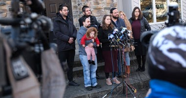 Surrounded primarily by family, Nicky Kohen, the daughter of Josef Neumann who was critically injured in an attack on a Hanukkah celebration, speaks to reporters in front of her home in New City, N.Y., Thursday, Jan. 2, 2020.