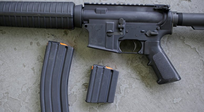 Stag arms AR-15 rifle with 30 round, left, and 10 round magazines