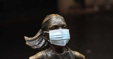 Mask placed on fearless girl