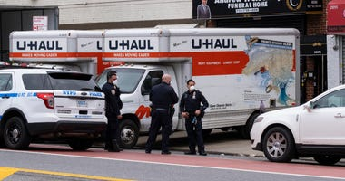 U-Haul trucks outside of the funeral home