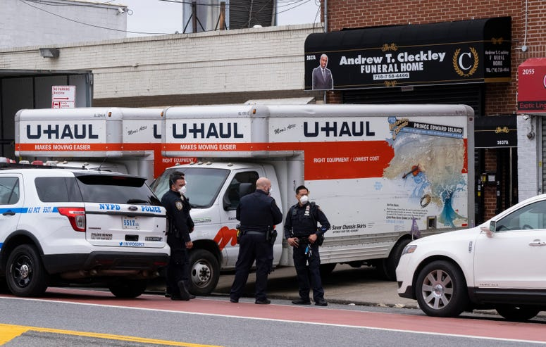 U-Haul trucks outside of the funeral home