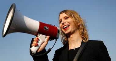 In this April 18, 2018, file photo, Chelsea Manning addresses participants at an anti-fracking rally in Baltimore. Convicted classified document leaker Chelsea Manning will not be allowed to enter Australia for a speaking tour