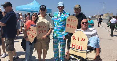 A morbid protest on beautiful opening day at Rockaway beach.