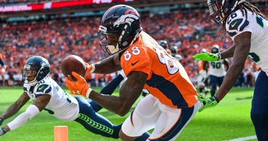 Demaryius Thomas of the Denver Broncos tries to make a catch in the end zone against the Seattle Seahawks in 2018.