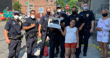 NYPD officers with girl a happy birthday