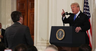 U.S. President Donald Trump answers a question from Jim Acosta of CNN after giving remarks a day after the midterm elections