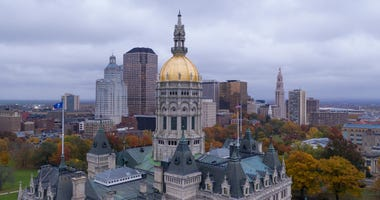 Downtown buildings under a dark sky at the Connecticut state capitol building in Hartford.