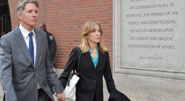 Felicity Huffman exits the John Joseph Moakley U.S. Courthouse after appearing in Federal Court to answer charges stemming from college admissions scandal on April 3, 2019