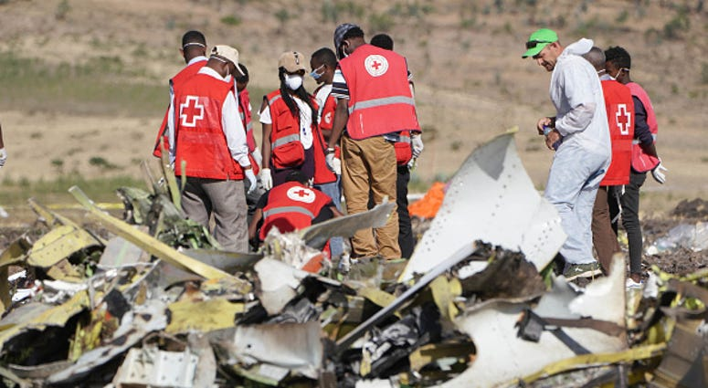 Forensics investigators and recovery teams collect personal effects and other materials from the crash site of Ethiopian Airlines Flight ET 302 on March 12, 2019 in Bishoftu, Ethiopia.