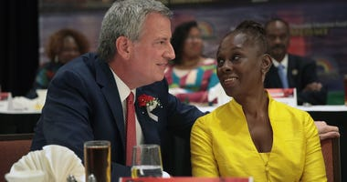 Democratic presidential candidate and New York City mayor Bill De Blasio speaks to his wife Chirlane McCray at the Rainbow PUSH Coalition Annual International Convention on July 1, 2019 in Chicago, Illinois.