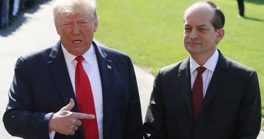 U.S. President Donald Trump stands with Labor SecretaryAlex Acosta,who announced his resignation, while talking to the media at the White House on July 12, 2019 in Washington, DC.