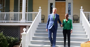 New York City Mayor Bill de Blasio arrives with his wife Chirlane McCray to a press conference in front of Gracie Mansion on September 20, 2019 in New York City.