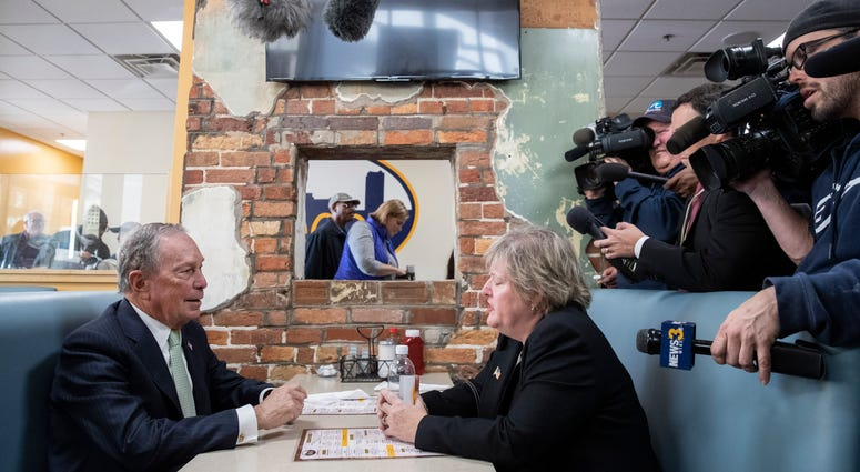 Newly announced Democratic presidential candidate, former New York Mayor Michael Bloomberg meets with Virginia House Delegate-Elect Nancy Guy at a coffee shop on November 25, 2019 in Norfolk, Virginia.