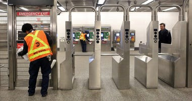 MTA worker cleans subway station