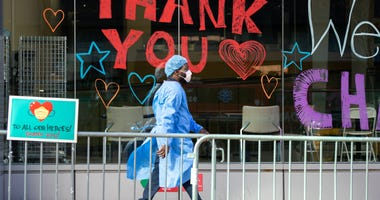 A Montefiore Medical Center employee walks past signs thanking the medical staff on April 9, 2020 in New York City.