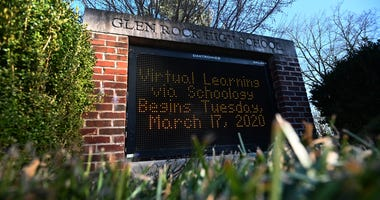 A sign displays the message that Glen Rock High School will transition to virtual learning starting Tuesday, March 17 as the coronavirus continues to spread across the United States on March 15, 2020 in Glen Rock, New Jersey.