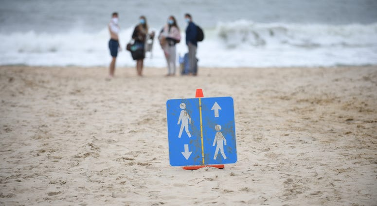 Signs are placed on the beach to direct people on how to keep social distance during Memorial Day weekend on May 24, 2020 in Montauk, New York.