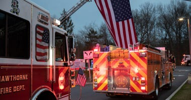 Fire trucks depart the Westchester Medical Center on April 14, 2020 in Valhalla, New York during the coronavirus crisis.