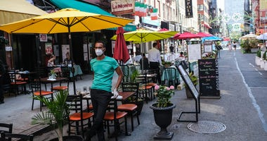 People dine al fresco in Little Italy on Mulberry Street between Hester and Broome Streets on July 4, 2020 in the Manhattan borough of New York City.