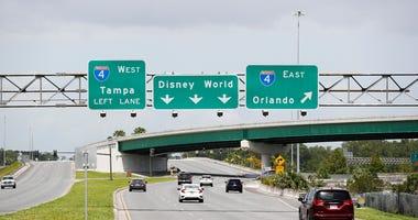 Signs directing motorists near the Walt Disney World theme park on July 9, 2020 in Lake Buena Vista, Florida.