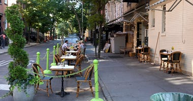 A restaurant in the West Village serves customers seated at sidewalk tables as the city moves into Phase 2 of re-opening following restrictions imposed to curb the coronavirus pandemic on June 22, 2020 in New York City.
