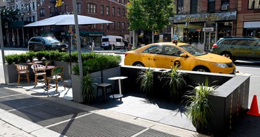 An outdoor dining area is seen as the city continues Phase 4 of re-opening following restrictions imposed to slow the spread of coronavirus on July 27, 2020 in New York City.