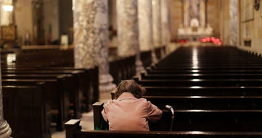 A woman prays in a Catholic church on May 20, 2013 in Waterbury, Connecticut.