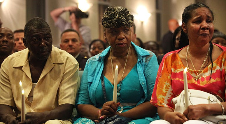 Eric Garner's stepfather, Benjamin Carr, mother Gwen Carr and his widow Esaw Garner (R)