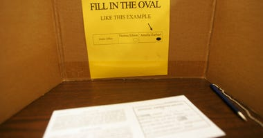 An absentee ballot sits in a voting screen October 29, 2004 in Brooklyn, New York.