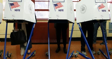 Voters cast their ballots at voting booths at PS198M The Straus School on November 8, 2016 in New York City, New York.