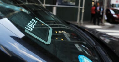 An Uber car waits for a client in Manhattan.