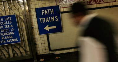 A man walks to the World Trade Center PATH train station platforms May 14, 2007 in New York City.