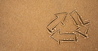 Recycle symbol on beach