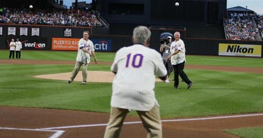 Tom Seaver and Jerry Koosman throw out the first pitch during the presentation commemorating the New York Mets 40th anniversary of the 1969 World Championship team on August 22, 2009