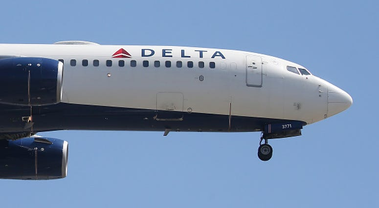 A Delta Air Lines plane lands at Los Angeles International Airport