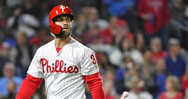 Bryce Harper of the Philadelphia Phillies walks away after striking out.