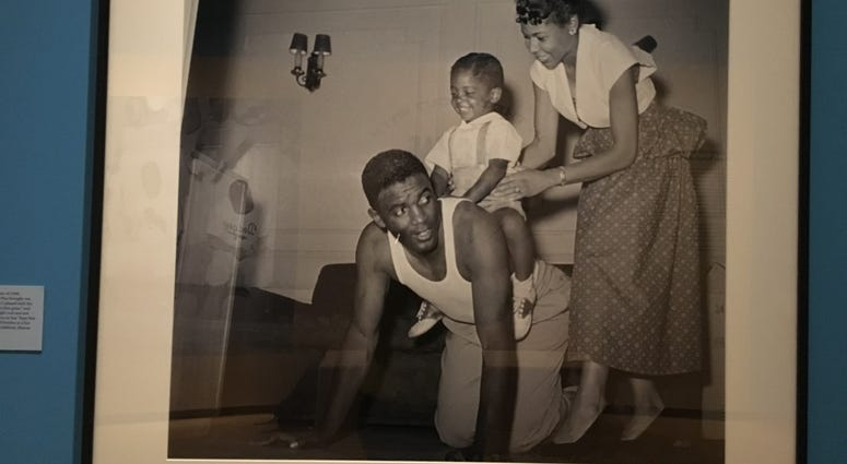 Jackie Robinson with wife and son Jackie Jr.